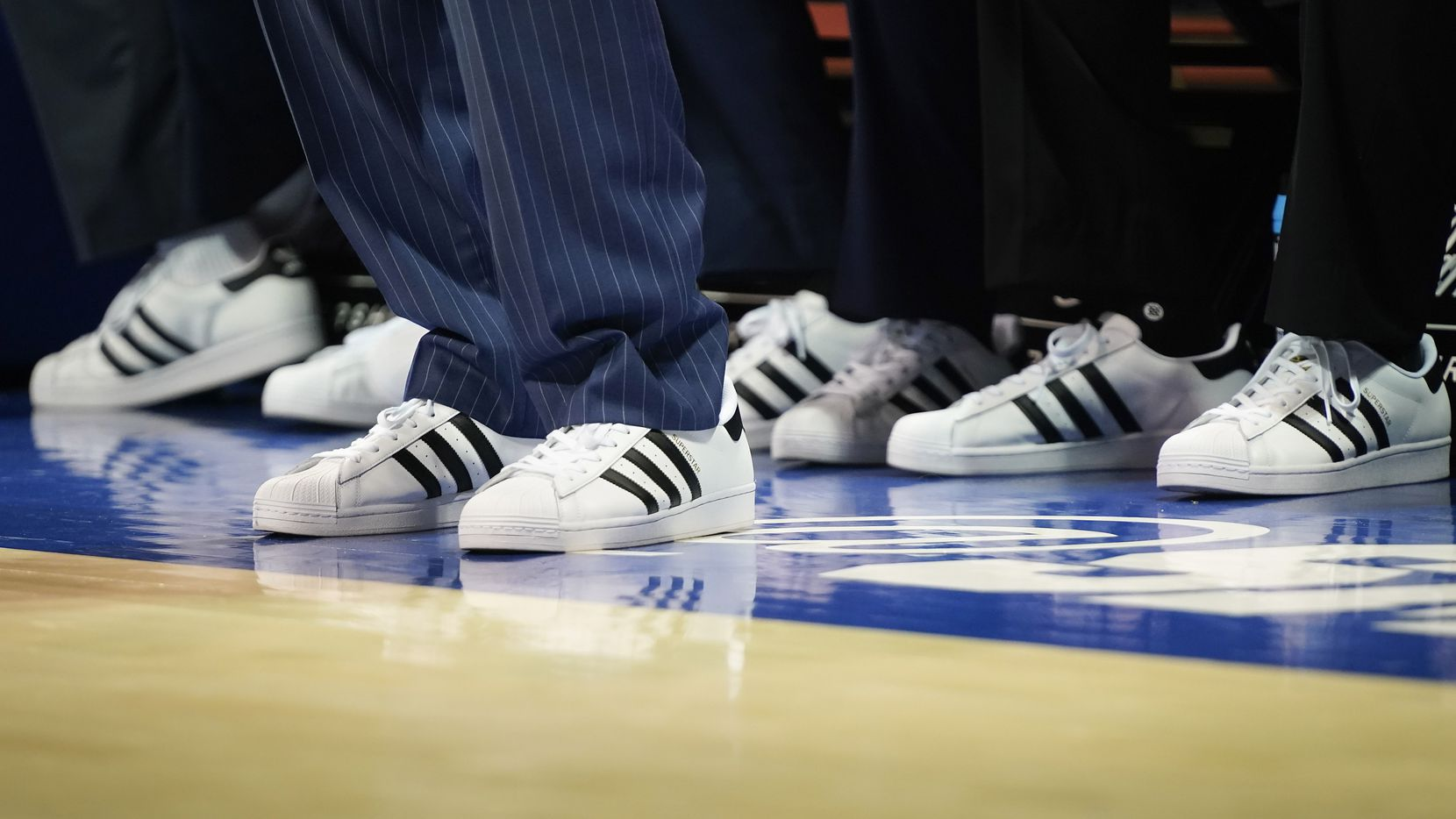 East Carolina coaches wear matching sneakers as part if Coaches vs. Cancer Suits And Sneakers Week during the first half of an NCAA basketball game against SMU at Moody Coliseum on Wednesday, Jan. 22, 2020, in Dallas.