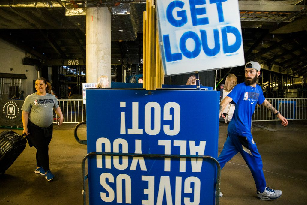 Mavs employees remove signs from the court after the Dallas Mavericks beat the Denver Nuggets 113-97 on Wednesday, March 11, 2020 at American Airlines Center in Dallas. During the game, the NBA suspended all games due to the spread of the new coronavirus. (Ashley Landis/The Dallas Morning News)