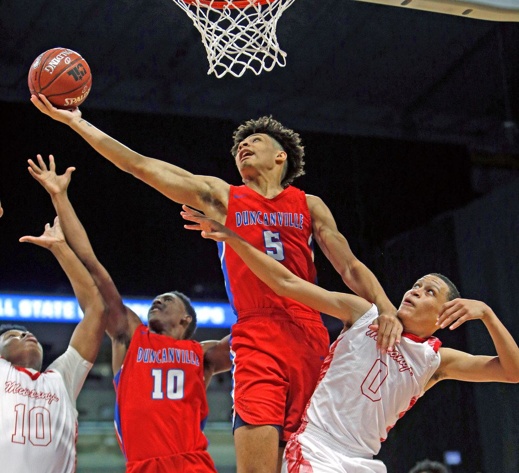 Duncanville's Micah Peavy #5 reaches for a rebound over Galena Park North's Joshua Cooper #0 and tips in for a basket. UIL boys basketball 6A State semi-final between Galena Park and Duncanville on Friday, March 8, 2019 at the Alamodome in San Antonio, Texas. (Ron Cortes/ Special Contributor) ORG XMIT: 10044094A
