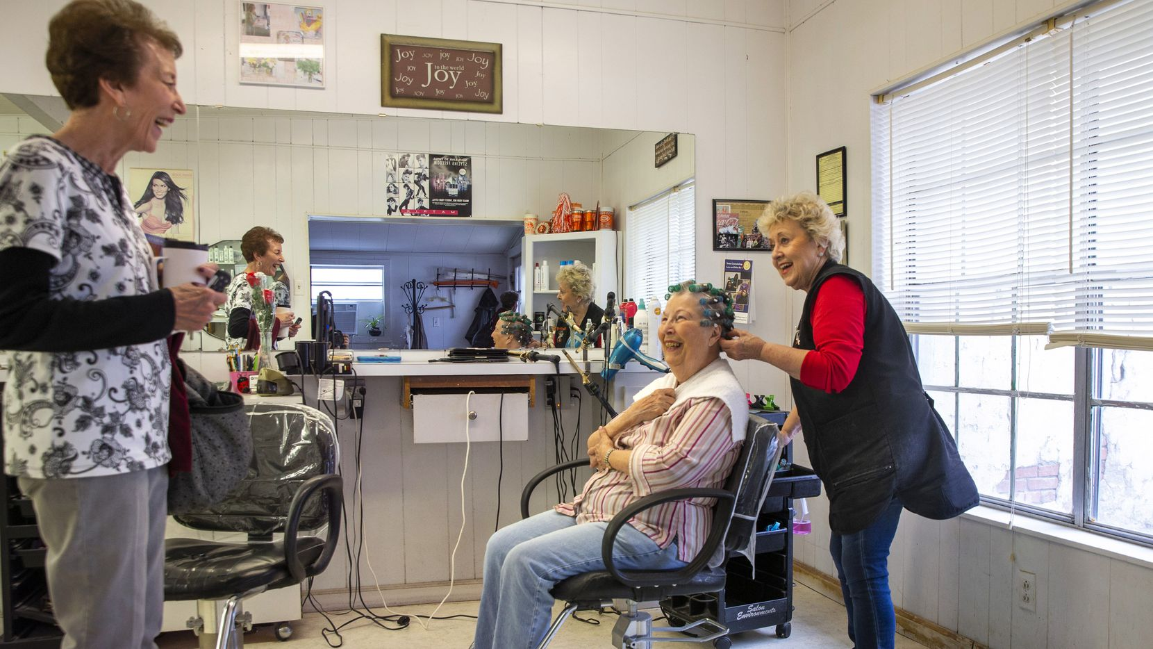 Mary Ann Ashby (left) says goodbye to Gayle Shackleford (center) and Shirley O'Neal as she leaves Shirley's Hair Shop in Celina on Nov. 21, 2019.