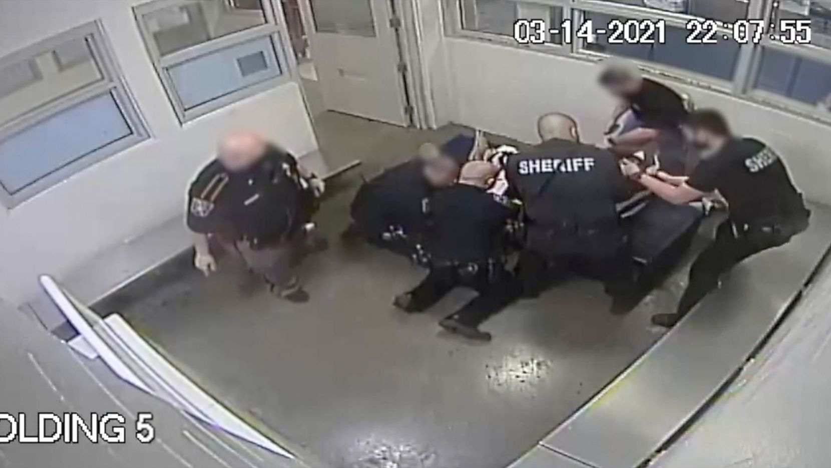 This image taken from video released by the Collin County Sheriff's Office shows jailers restraining Marvin Scott III before the 26-year-old's death while in custody at the Collin County Detention Center on March 14, 2021.