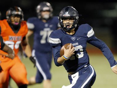 Frisco Lone Star quarterback Garrett Rangel (13) carries the ball against Lancaster during the first half of their Class 5A Division I Regional championship game at Wilkerson-Sanders Stadium in Rockwall, Texas, Friday, December 6, 2019. (Tom Fox/The Dallas Morning News)
