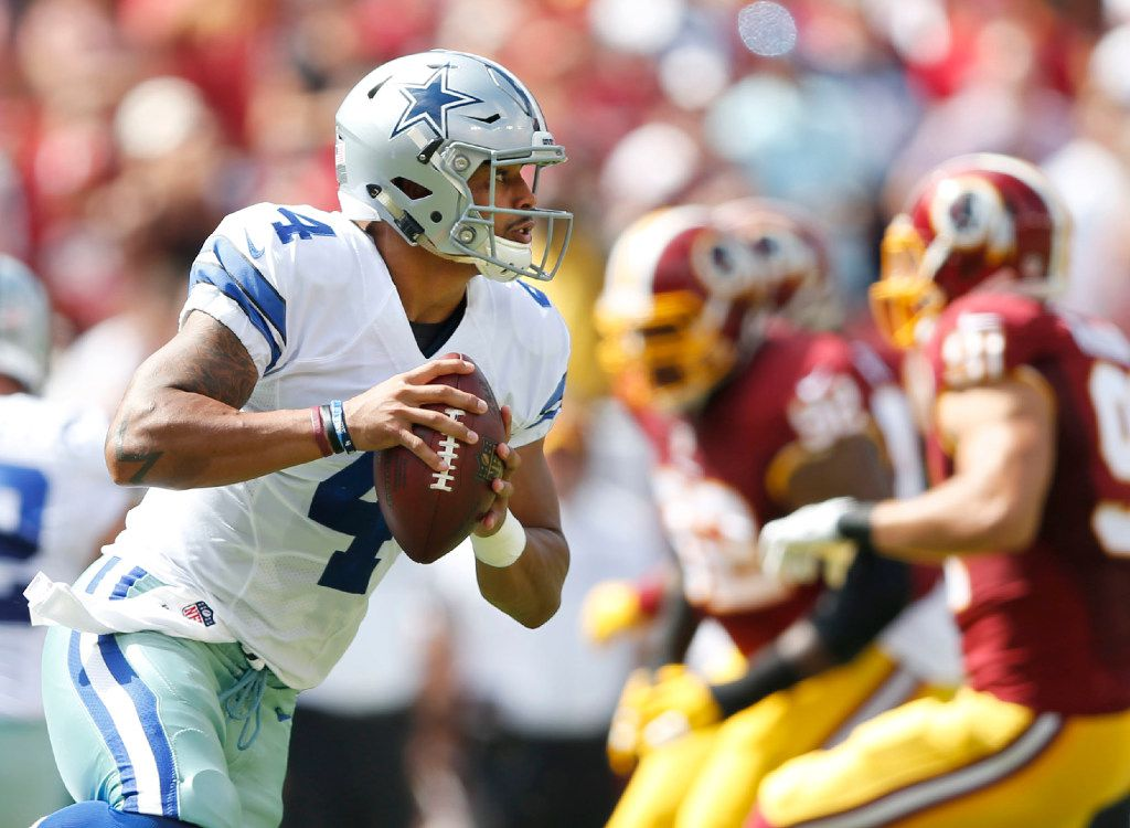 Dallas Cowboys quarterback Dak Prescott (4) rolls out of the pocket in a game against the Washington Redskins during the first quarter of play at FedEx Field in Landover, Maryland on Sunday, September 18, 2016. (Vernon Bryant/The Dallas Morning News)