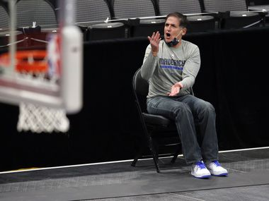 Mavericks owner Mark Cuban argues a call from his socially distanced seat along the sideline during a preseason game against the Timberwolves at American Airlines Center in Dallas on Thursday, Dec. 17, 2020.