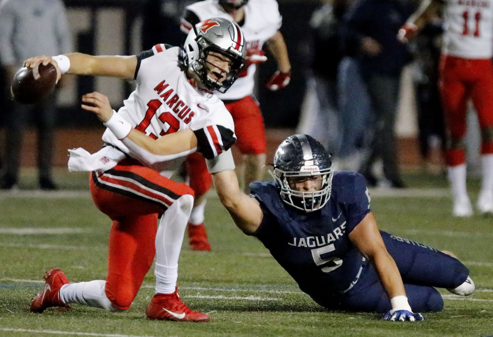 Flower Mound High School defensive end Stone Eby (5) brings down Flower Mound Marcus quarterback Garrett Nussmeier (13) for a sack during the first half as Flower Mound High School hosted Flower Mound Marcus High School at Neal E. Wilson Jaguar Stadium on Friday night, October 23, 2020. (Stewart F. House/Special Contributor)
