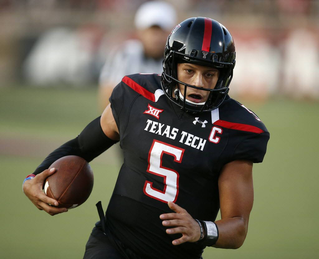 Texas Tech's Pat Mahomes runs the ball into the end zone to score his first touchdown against Stephen F. Austin during an NCAA college football game Saturday, Sept. 3, 2016, in Lubbock, Texas. (Brad Tollefson/Lubbock Avalanche-Journal via AP)