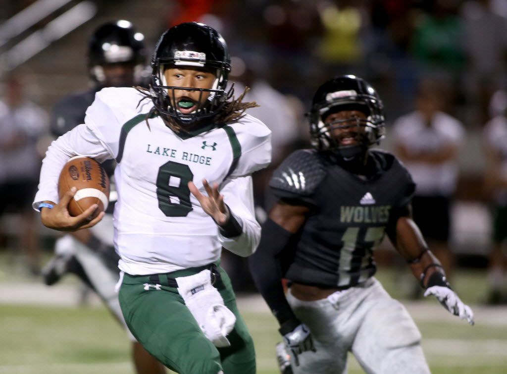 Lake Ridge's  Jett Duffey (8) slips the tackle of Timberview's Kenneth Gary Jr. (17), as Mansfield Lake Ridge faces Mansfield Timberview at Vernon Newsom Stadium in Mansfield, Texas, on Friday, Oct. 9, 2015. (Rick Moon/Special contributor)