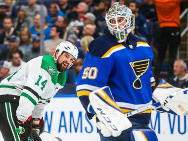 Dallas Stars left wing Jamie Benn (14) looks at St. Louis Blues goaltender Jordan Binnington (50) during a timeout during the second period in game 5 of an NHL second round playoff series at Enterprise Center in St. Louis, Missouri on Friday, May 3, 2019.
