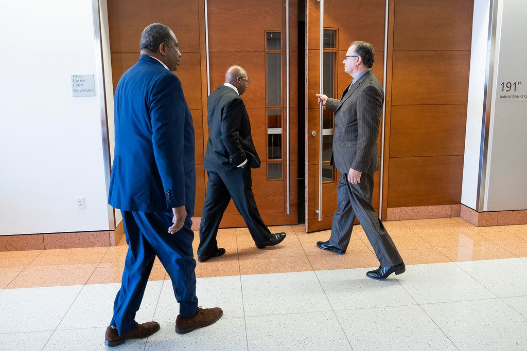 Chris Caso,interim Dallas city attorney (right) holds the door for Dallas council member Tennell Atkins and State Sen. Royce West to enter a hearing at Judge Gena Slaughter's courtroom at the  George L. Allen, Sr. Courts Building on Thursday, March 21, 2019.  A hearing was held Thursday on the fate of what has become known as Shingle Mountain in southeast Dallas. (Smiley N. Pool/The Dallas Morning News)