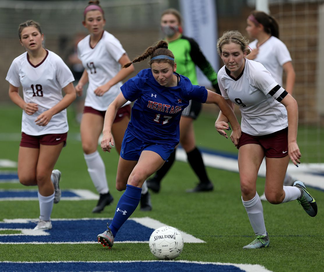 Midlothian Heritage's Kerry Scott (17) goes up against Calallen's Maddie Pearl (8) during their UIL 4A girls State championship soccer game at Birkelbach Field on April 16, 2021 in Georgetown, Texas.  (Thao Nguyen/Special Contributor)