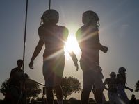 The sun begins to set behind the All Saints' Episcopal School varsity football team as they prepare for a game against Bishop Dunne Catholic School at Young Field McNair Stadium in Fort Worth, Texas, on Friday, Sep. 27, 2019.