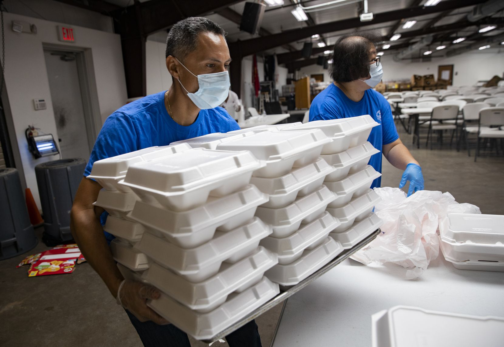 Rham Sandoval of Stonebriar Community Church in Frisco helped prepare meals at Cornerstone Community Development Corp. in Dallas on Saturday.