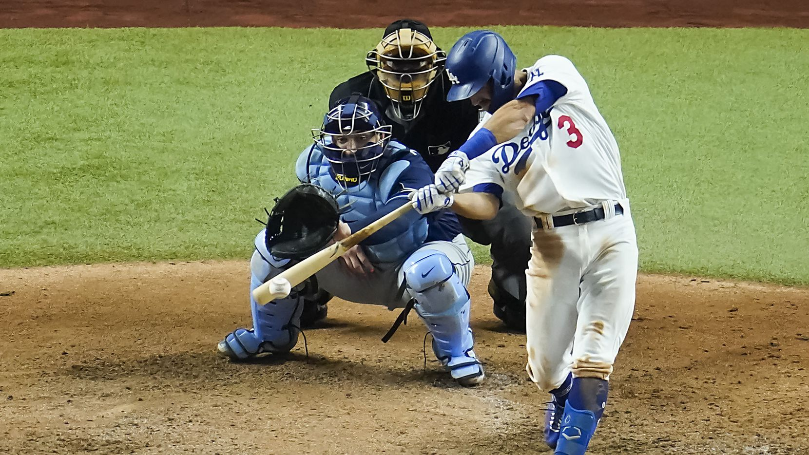 Los Angeles Dodgers second baseman Chris Taylor drives in a run with a single during the fifth inning in Game 1 of the World Series against the Tampa Bay Rays at Globe Life Field on Tuesday, Oct. 20, 2020.