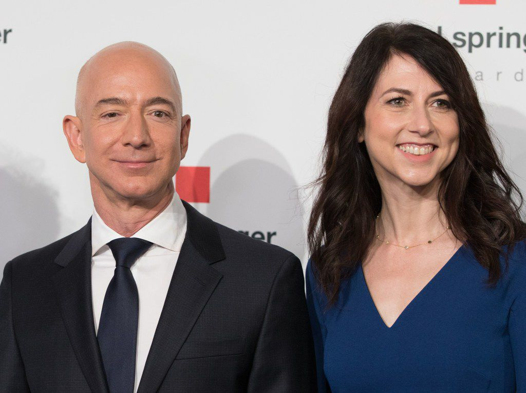 "(FILES) In this file photo taken on April 24, 2018 Amazon CEO Jeff Bezos and his wife MacKenzie Bezos  poses as they arrive at the headquarters of publisher Axel-Springer where he will receive the Axel Springer Award 2018 in Berlin. - Amazon founder Jeff Bezos, rated the world's wealthiest person, announced on January 9, 2019 on Twitter that he and his wife Mackenzie Bezos were divorcing after a long separation. ""We want to make people aware of a development in our lives,"" Jeff Bezos, 54, and MacKenzie Bezos, 48, said in joint statement posted to Bezos' Twitter feed. (Photo by JORG CARSTENSEN / dpa / AFP)JORG CARSTENSEN/AFP/Getty Images"