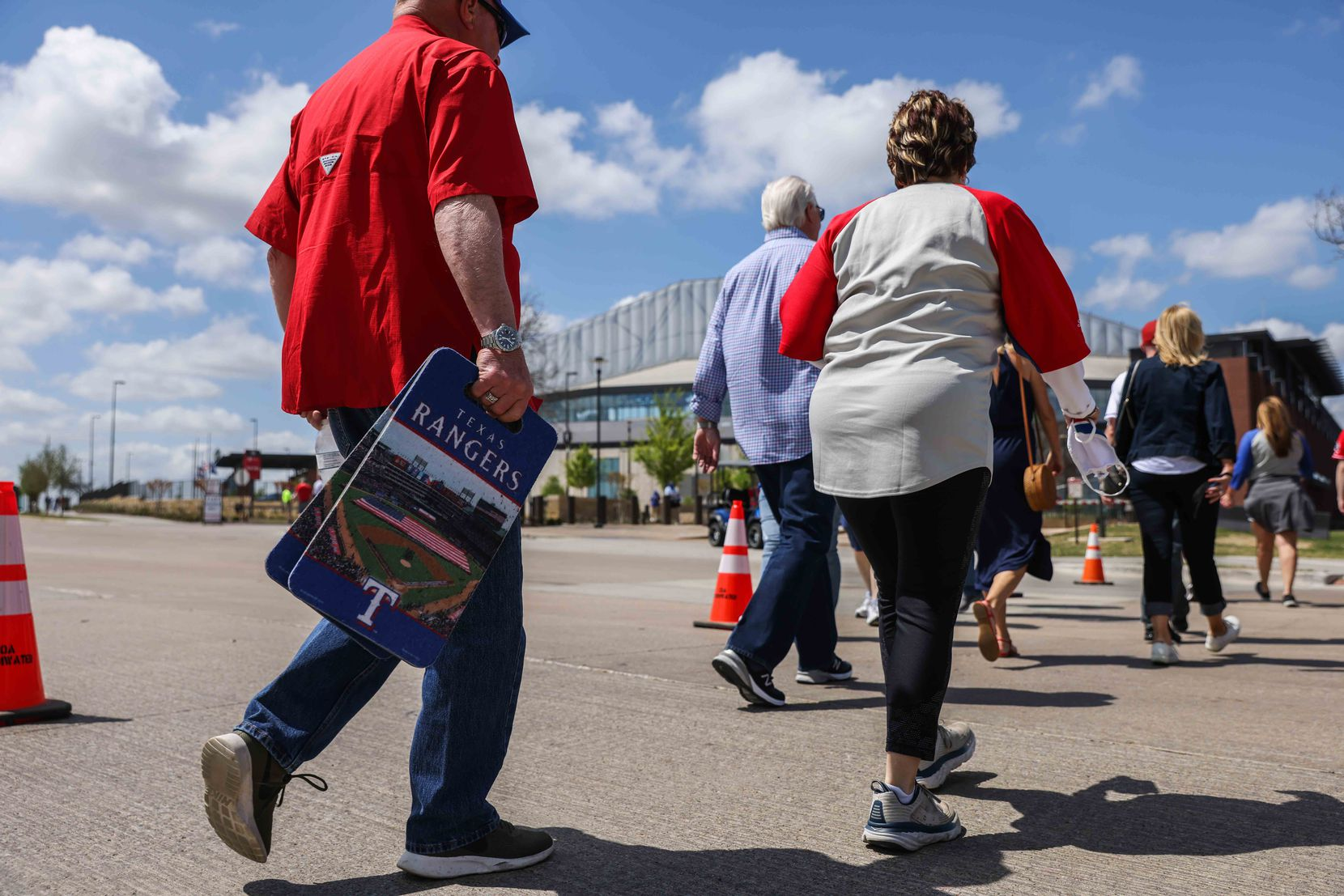 Fans walk to the Globe Life Field entrance to attend the game between Texas Rangers and Toronto Blue Jays on opening day in Arlington, Texas on Monday, April 5, 2021. (Lola Gomez/The Dallas Morning News)