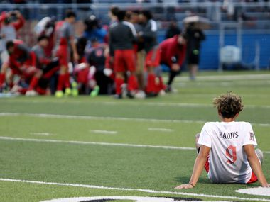 Rockwall-Heath's Chuy Ruiz (9) watches the SA Lee team celebrate after their UIL 6A boys State championship soccer game at Birkelbach Field on April 17, 2021 in Georgetown, Texas. SA Lee won 2-0.
