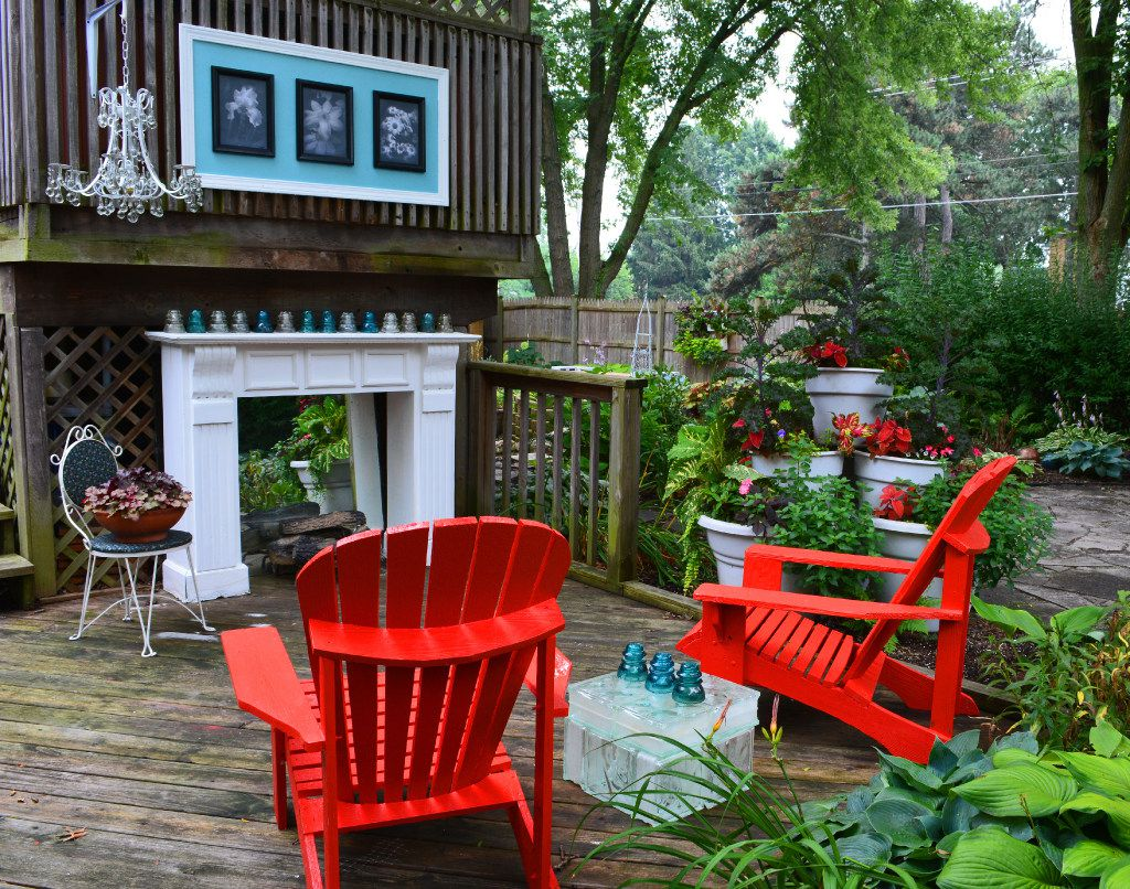 """A recycled chandelier makes the garden room  from """"101 Organic Gardening Hacks: Eco-friendly Solutions to Improve Any Garden."""""""