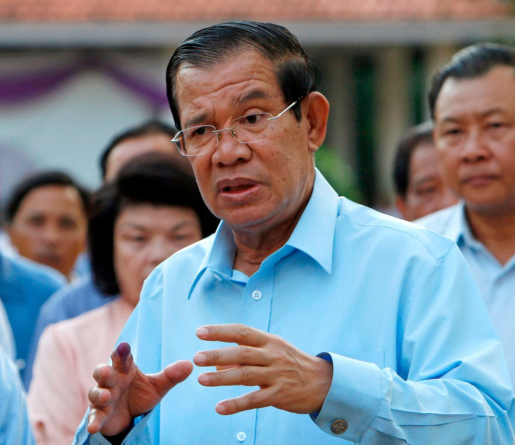 In this Feb. 25, 2018, file photo, Cambodian Prime Minister Hun Sen speaks after voting in the senate election at Takhmau polling station in Kandal province, southeast of Phnom Penh, Cambodia. Registration began on Monday, April 30, 2018 for political parties contesting Cambodia's upcoming general election, with Hun Sen dismissing calls for a boycott of the polls by opposition figures whose party was dissolved by the pro-government courts last year. Hun Sen in a speech Monday said the July 29 polls will proceed as planned and not be obstructed by any individuals or groups.