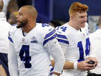 FILE - Cowboys quarterback Dak Prescott (4) is pictured alongside quarterback Andy Dalton (14) on the sideline during the second quarter of a game against the Giants at AT&T Stadium in Arlington on Sunday, Oct. 11, 2020.