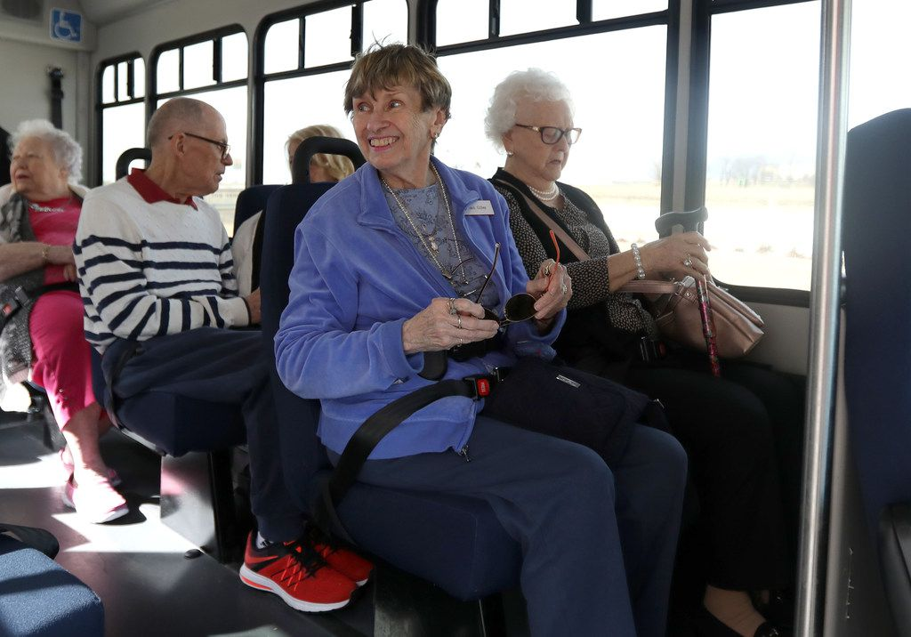 Joan Giles (left) sits next to Lorene Mathis as they wait for their Envoy America bus to leave The Heritage at Twin Creeks in Allen.