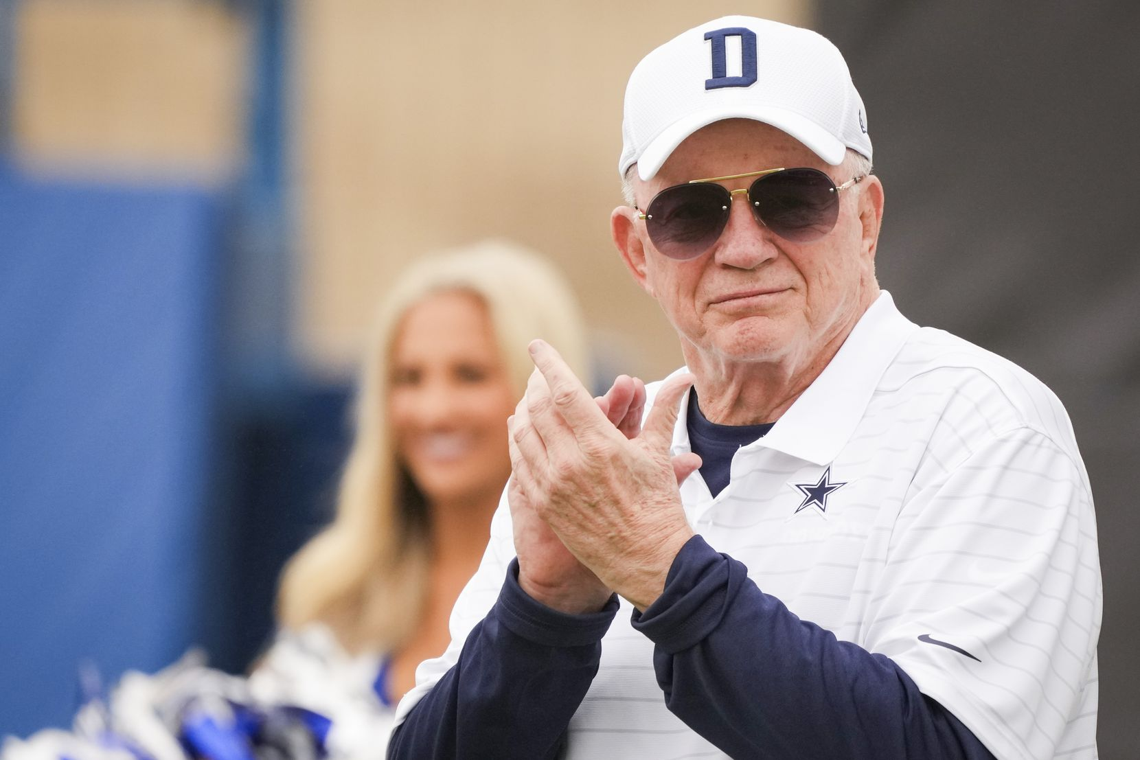 Owner and general manager Jerry Jones applauds a performance by the Dallas Cowboys cheerleaders during opening ceremonies before a practice at training camp on Saturday, July 24, 2021, in Oxnard, Calif. (Smiley N. Pool/The Dallas Morning News)