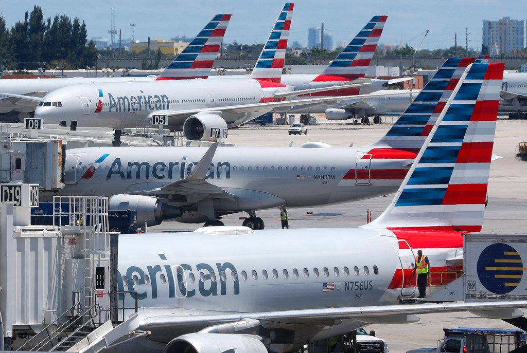 In this Wednesday, April 24, 2019, photo, American Airlines aircraft are shown parked at their gates at Miami International Airport in Miami. American Airlines is accusing its mechanics and their unions of conducting an illegal work slowdown to gain leverage in contract talks, and the airline is asking a federal judge to stop the activity. (AP Photo/Wilfredo Lee)