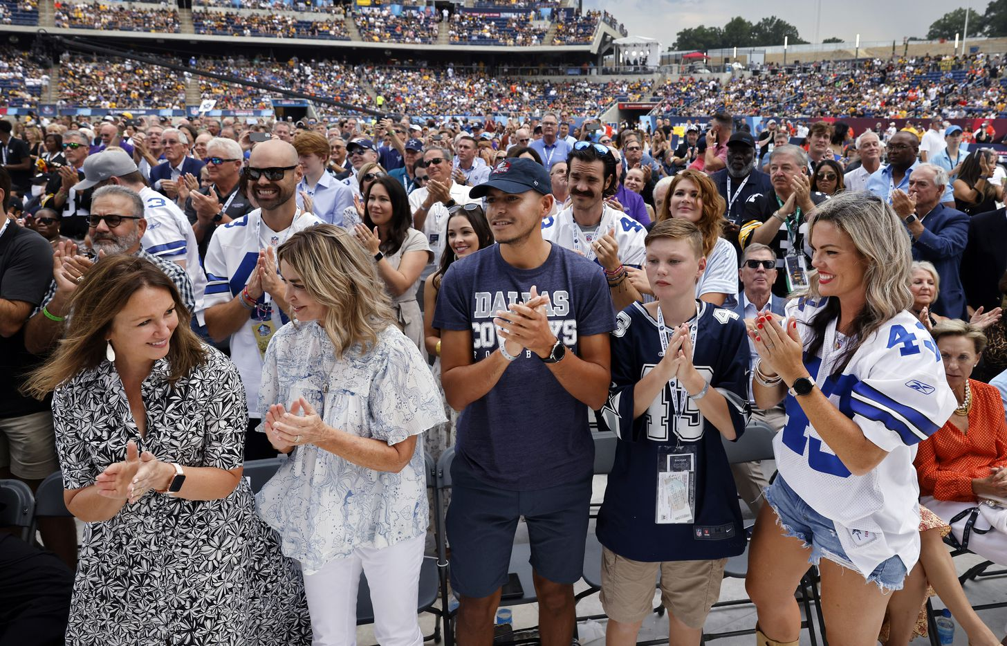 Dallas Cowboys player and Pro Football Hall of Fame inductee Cliff Harris' wife Karen Harris (left) applaud her husband alongside Rosie Waters (wife of presenter Charlie Waters), Christian Mendez, Kingston Harris and his mother Alden Harris (right) following the former Cowboy's speech at the Centennial Class of 2020 enshrinement ceremony at Tom Benson Hall of Fame Stadium in Canton, Ohio, Saturday, August 7, 2021. (Tom Fox/The Dallas Morning News)