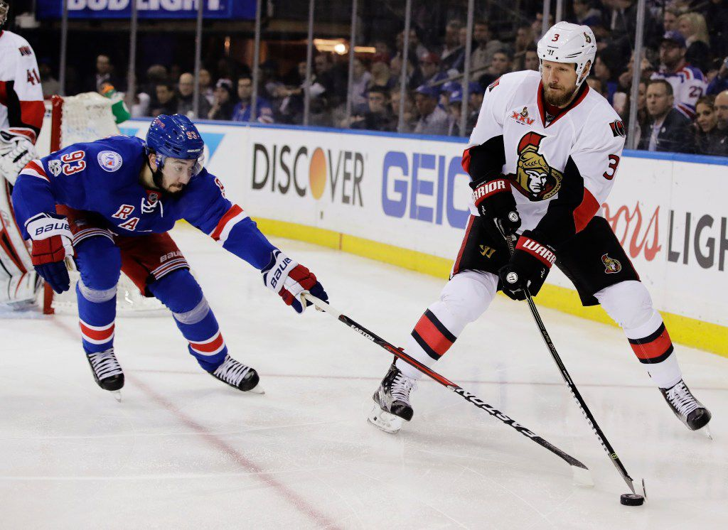 FILE - In this May 9, 2017, file photo, Ottawa Senators' Marc Methot, right, tries to keep the puck from New York Rangers' Mika Zibanejad during Game 6 of an NHL hockey Stanley Cup second-round playoff series in New York. The Vegas Golden Knights selected Methot in the expansion draft, Wednesday, June 21. (AP Photo/Frank Franklin II, File)