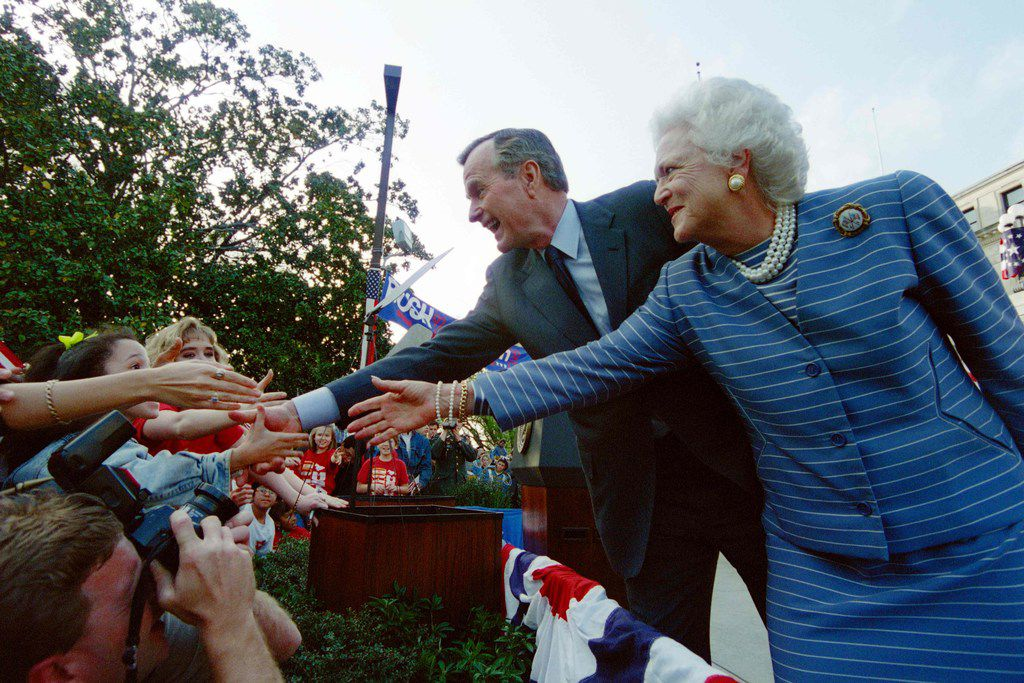 """Sen. John Cornyn, R-Texas, introduced a bill last week to authorize the creation of $1 coins to honor former President George H.W. Bush and his wife, Barbara. President George Bush and First Lady Barbara Bush shake hands with members of the crowd  at a """"Bush/Quayle 92"""" rally on the steps of the Mississippi State Capitol on March 6, 1992."""