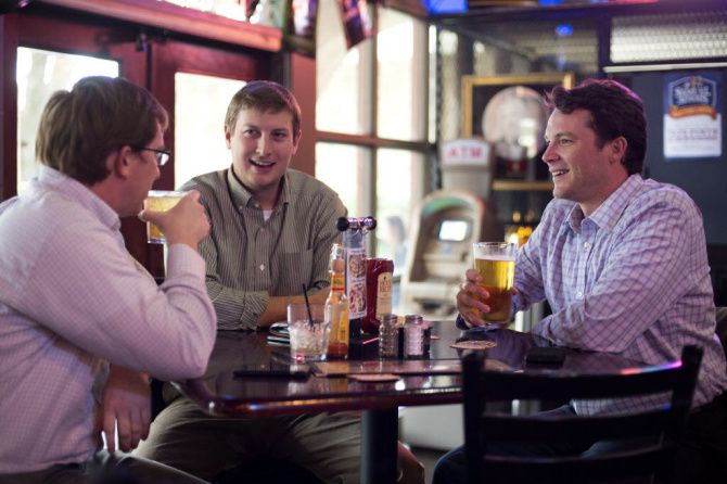 Luke Tyler, left, Brad Brady and Alex Prince enjoy beers during happy hour at The Cellar Restaurant & Bar in Las Colinas' Urban Center. Las Colinas was voted the best neighborhood for young adults in Irving, Coppell and Valley Ranch.  Staff photo by JEFFREY MCWHORTER/DMN