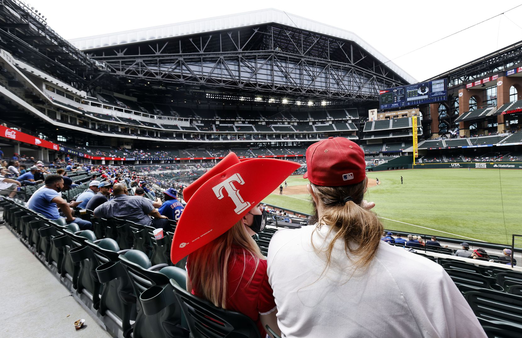 Texas Rangers fans take in an afternoon exhibition baseball game at Globe Life Field in Arlington, Texas. The Rangers were playing the Milwaukee Brewers, Tuesday, March 30, 2021. (Tom Fox/The Dallas Morning News)