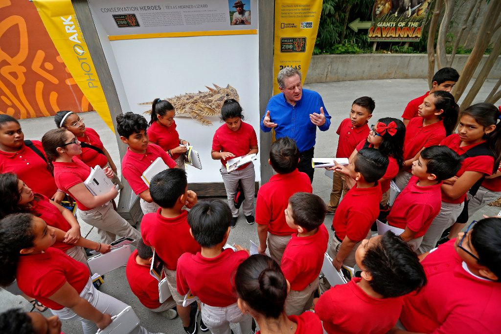 Photographer Joel Sartore talks with a group of students from Momentous Institute about his photograph of Texas Horned Lizard during the National Geographic Photo Ark exhibit at Dallas Zoo in Dallas, Thursday, April 20, 2017. (Jae S. Lee/The Dallas Morning News)