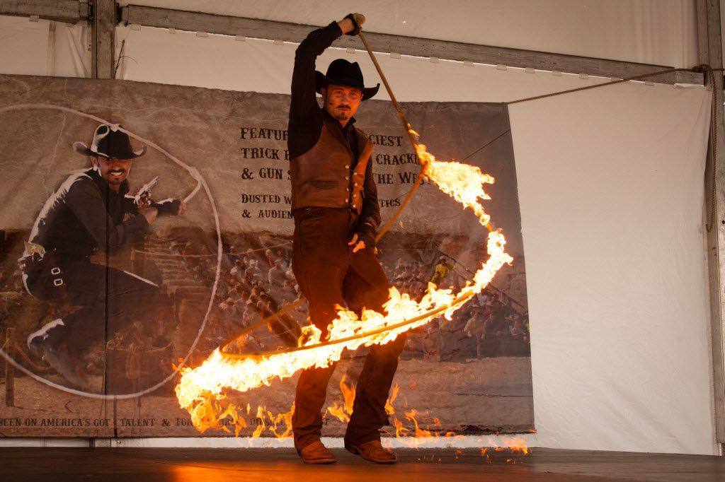 Western performer, Loop Rawlins, twirls a flaming lasso during a show at the North Texas Fair and Rodeo.  The rain came down early this morning and caused the North Texas Fair and Rodeo parade to be cancelled.  The rain eventually cleared later in the early afternoon, Saturday, August 20, 2016, in Denton, Texas. Jeff Woo/DRC