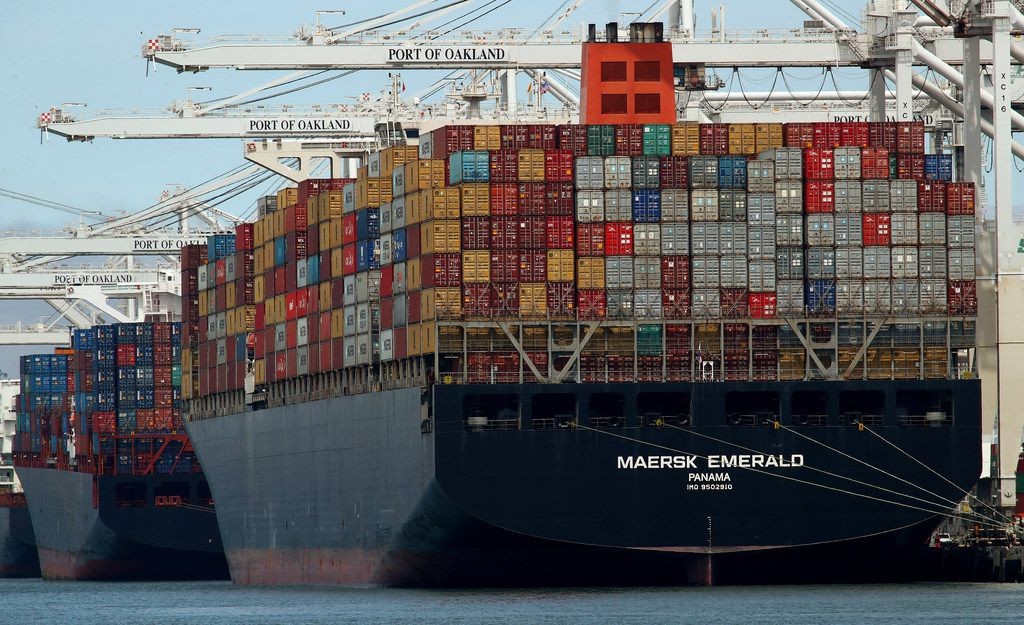 The container ship Maersk Emerald is unloaded at the Port of Oakland, Calif.