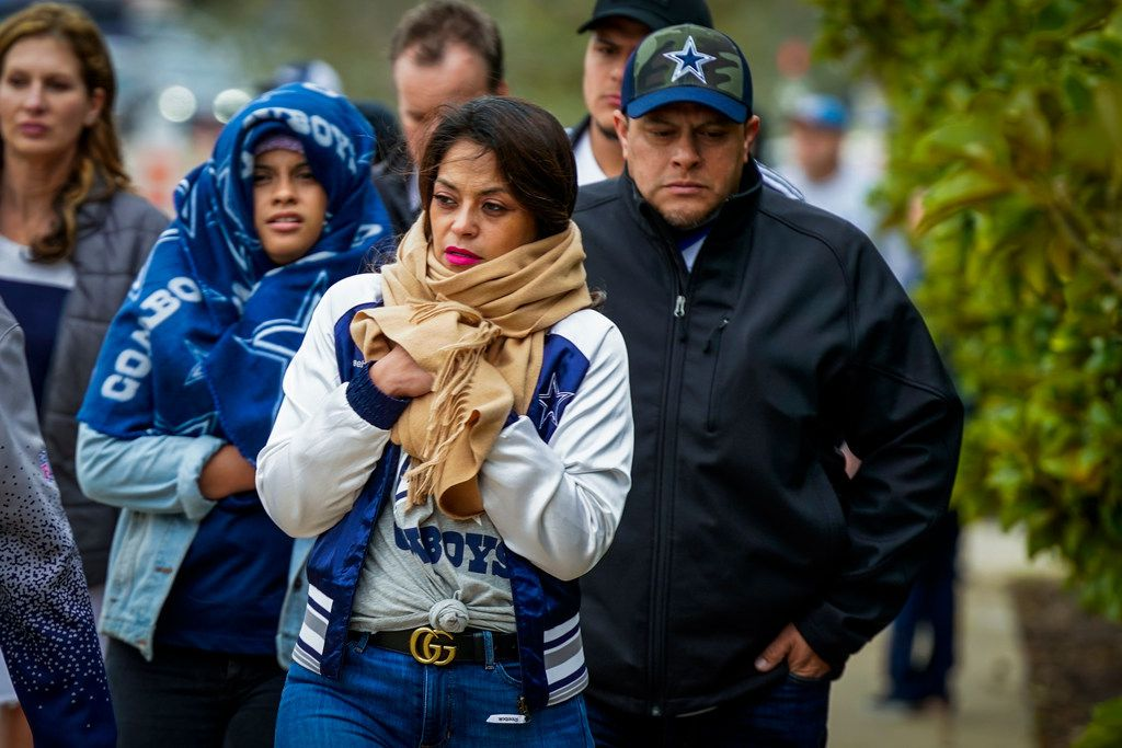 Bundled up fans head to the stadium before an NFL football game between the Dallas Cowboys and the Buffalo Bills at AT&T Stadium on Thursday, Nov. 28, 2019, in Arlington. (Smiley N. Pool/The Dallas Morning News)