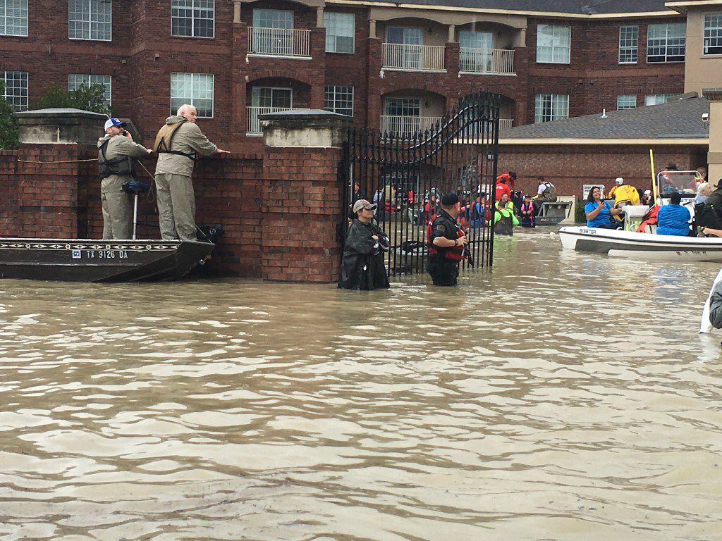 Rescue workers Tuesday outside the Arbor Terrace retirement community in the Kingwood community of Houston, on Tuesday, Aug. 29, 2017.