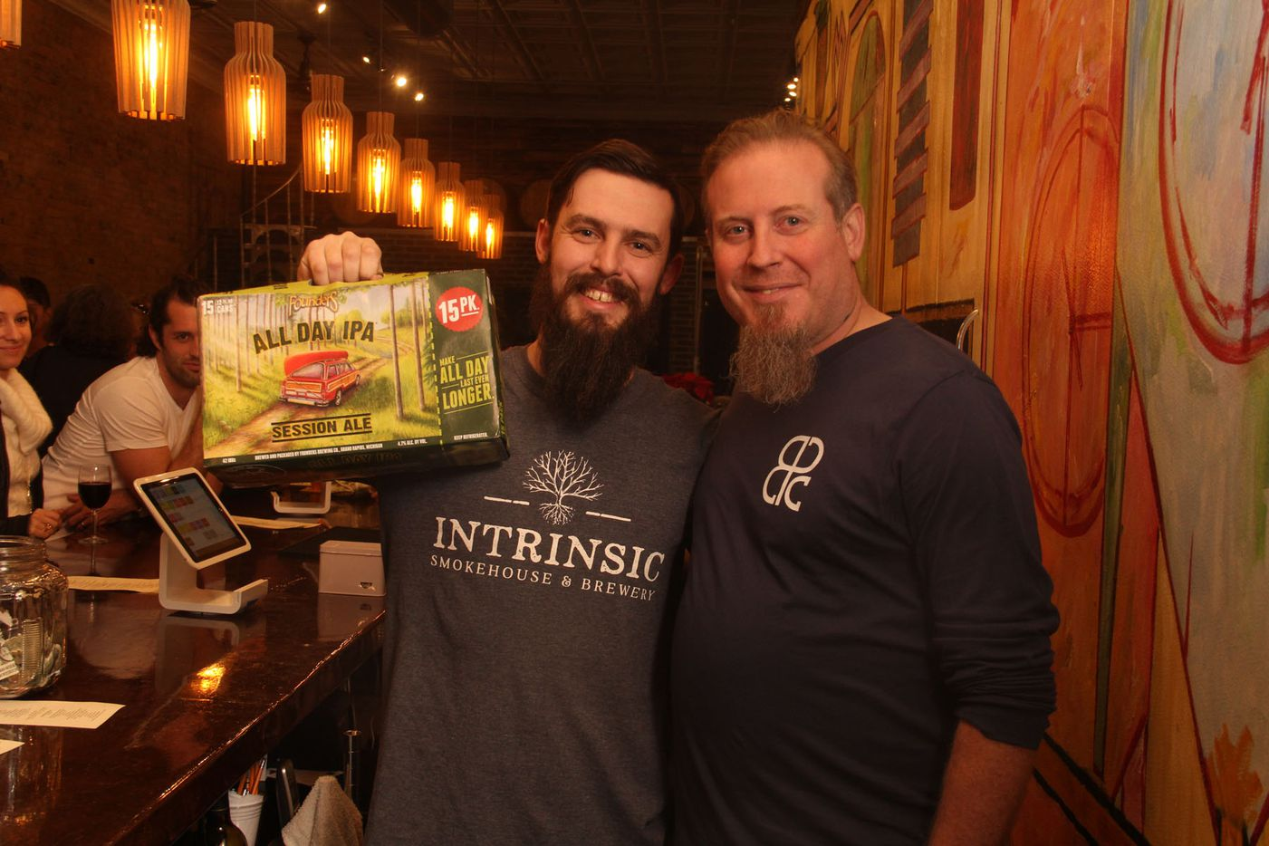 Beer rep. Tait Lifto dropping off a grand opening present to Intrinsic Smokehouse and Brewery owner Cary Hodson.