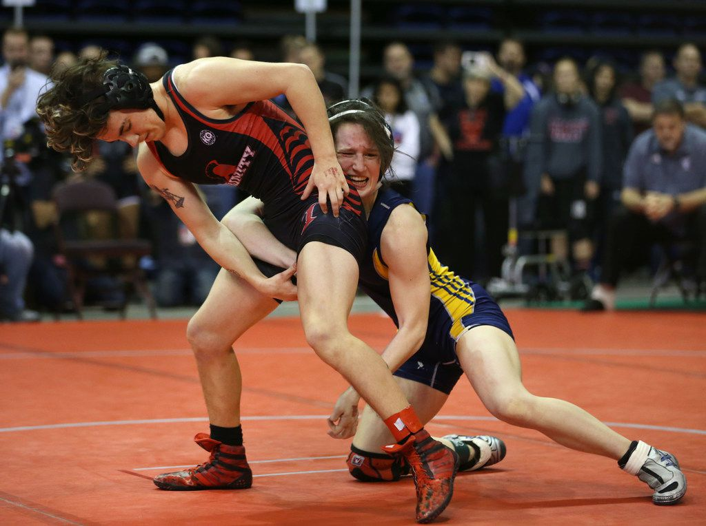 Euless Trinity's Mack Beggs (left), a transgender male, wrestles Cypress Ranch's Kayla Fitts during the girls semifinal round of the UIL Wrestling State Championship tournament at the Berry Center in Cypress, Texas on Saturday, Feb. 24, 2018. Mack Beggs won and will advance to the final round. (Rose Baca/The Dallas Morning News)