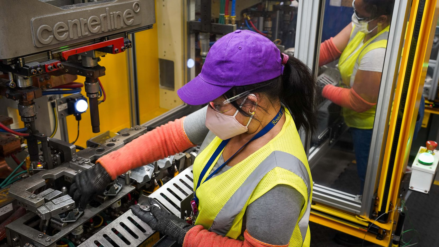 Sonia Benitez (foreground) and Isabel Rosario work a line at Flex-N-Gate in Grand Prairie, a facility that supplies parts for SUVs. Last month, U.S. manufacturers expanded at their fastest pace in 37 years, and Texas factories reported big gains in output, new orders, shipments and more.