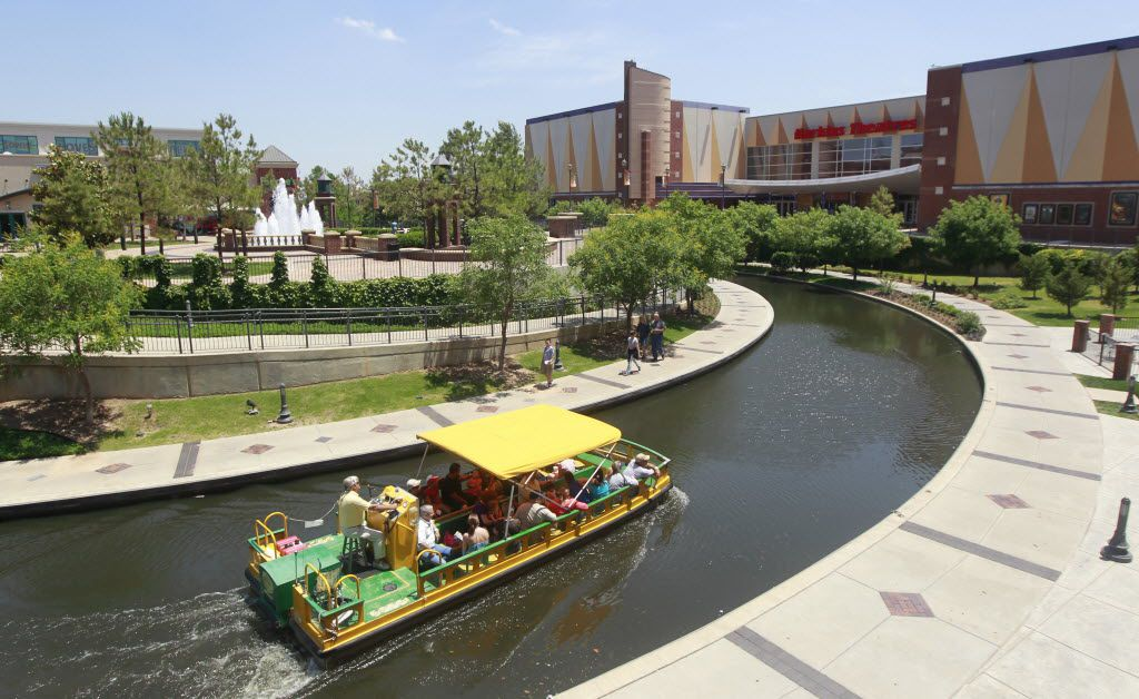 A water taxi navigates the Bricktown Canal in the Bricktown area of Oklahoma City.
