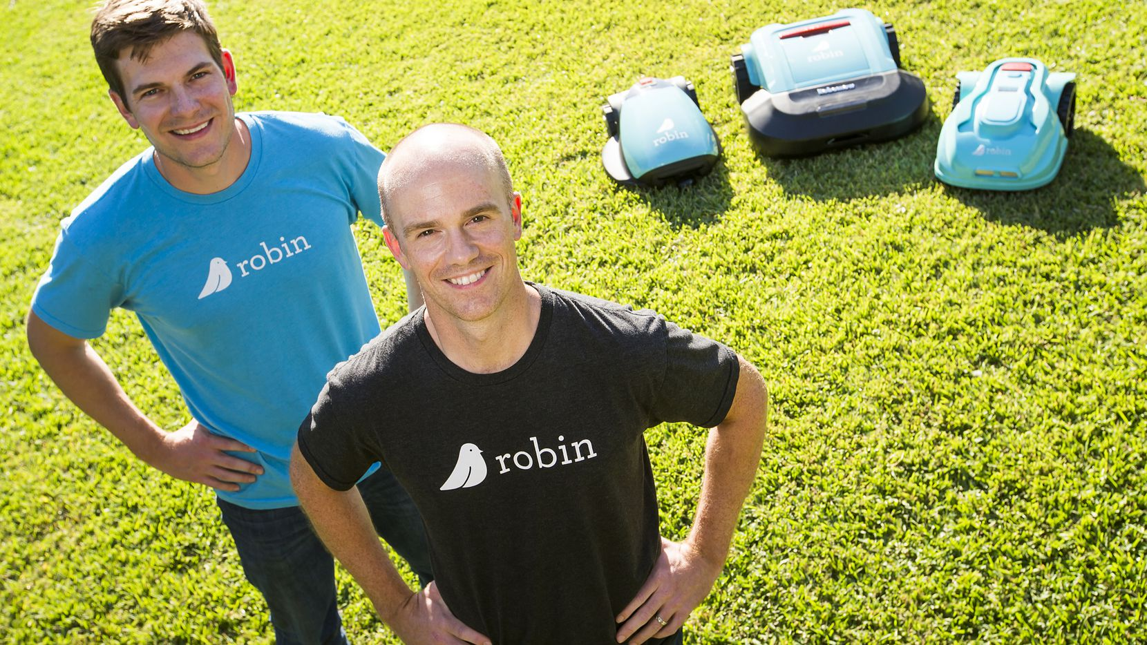 Robin cofounders Bart Lomont (left) and Justin Crandall with a few of their roomba-like lawnmowers on Monday, Oct. 17, 2016, in Dallas.  The Dallas lawn care company plans to launch a robotic service. (Smiley N. Pool/The Dallas Morning News)