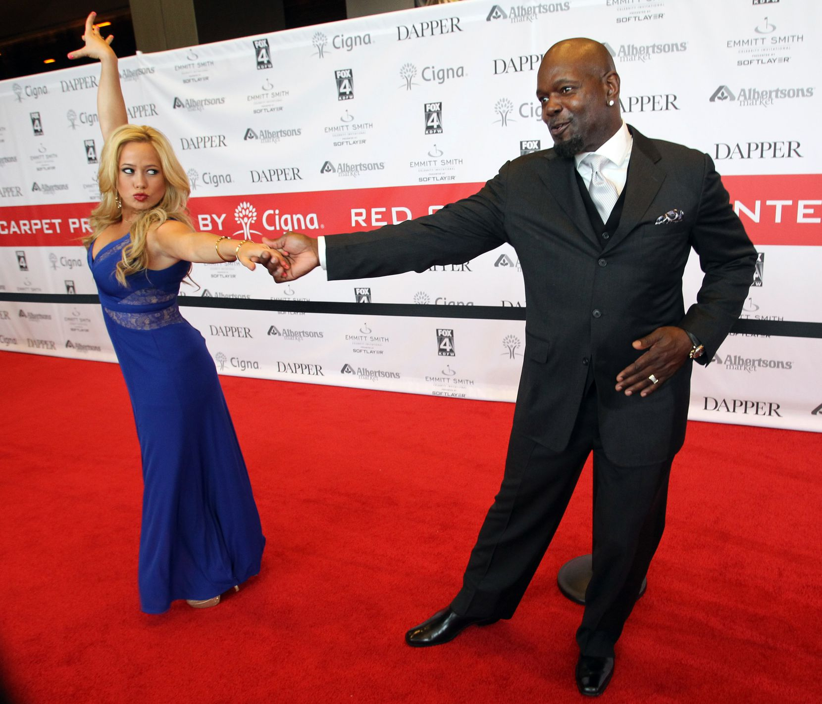 "Former Dallas Cowboys running back Emmitt Smith shows off a few of his dance moves with ""Dancing With the Stars"" Sabrina Bryan before the Pat & Emmitt Smith Charities' fourth annual Emmitt Smith Celebrity Invitational's ÒDancing with the Smiths,Ó  gala dinner at the Omni Hotel in Dallas on Friday, May 10, 2013. (Louis DeLuca/The Dallas Morning News)"