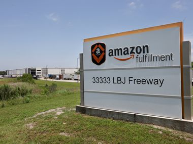 Delivery trucks wait to enter an Amazon Fulfillment Center in South Dallas in June.