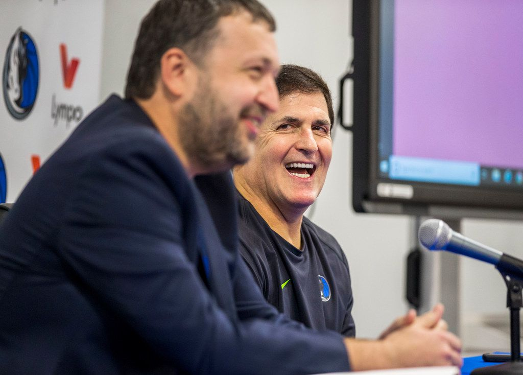 Antanas Guoga, co-founder of Lympo, left, talks with Mark Cuban, owner of the Dallas Mavericks, during a media conference at the Mavericks Training Center in Dallas on Nov. 16, 2018. The Mavericks partnered with Lympo, a fitness application that rewards its users for living a healthy lifestyle. (Carly Geraci/The Dallas Morning News)