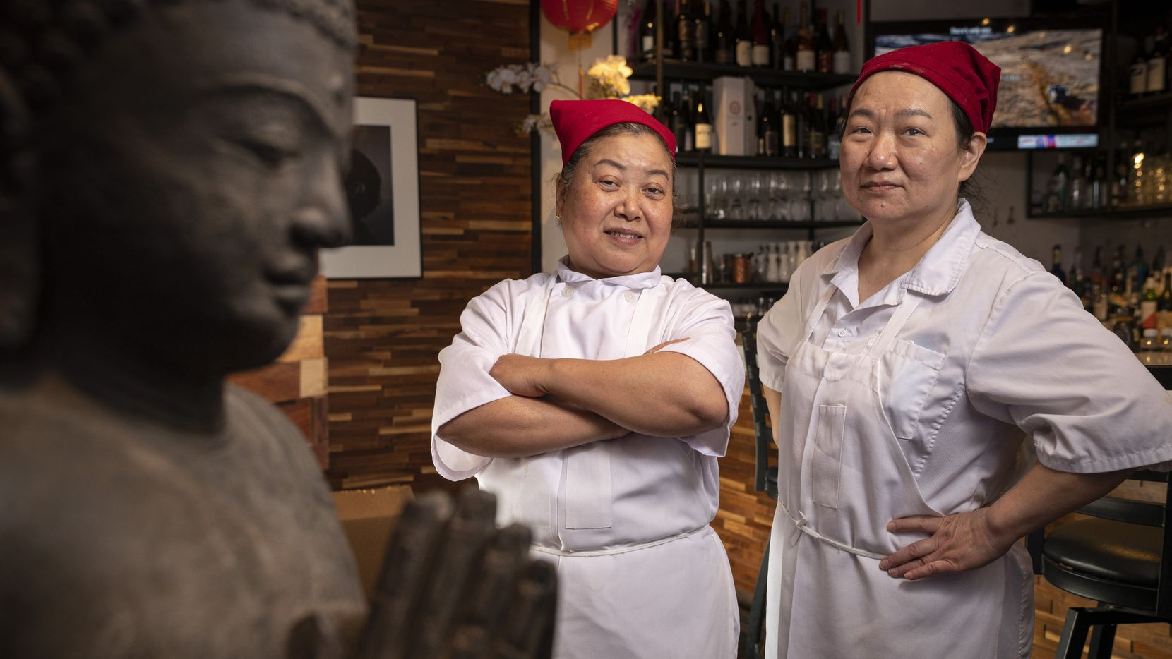 Dumpling makers Huajuan Shen, left, and Sophia Chen from Royal China restaurant in Dallas, on Tuesday, April 06, 2021.