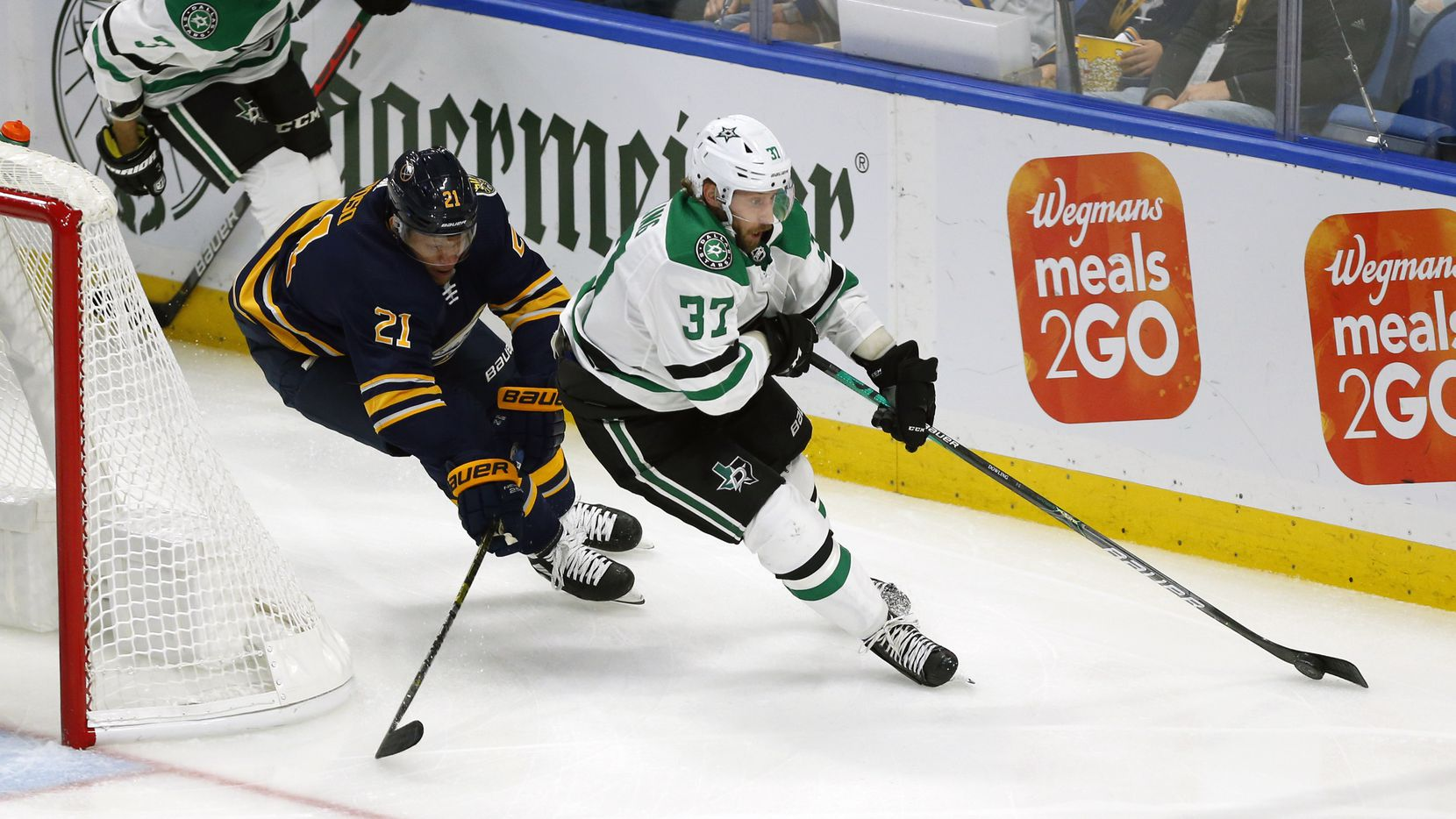 Buffalo Sabres forward Kyle Okposo (21) chases Dallas Stars forward Justin Dowling (37) during the first period of an NHL hockey game, Monday, Oct. 14, 2019, in Buffalo N.Y. (AP Photo/Jeffrey T. Barnes)