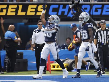 Dallas Cowboys running back Tony Pollard (20) celebrates his first quarter touchdown against the Los Angeles Chargers at SoFi Stadium in Inglewood, California, Sunday, September 19, 2021.