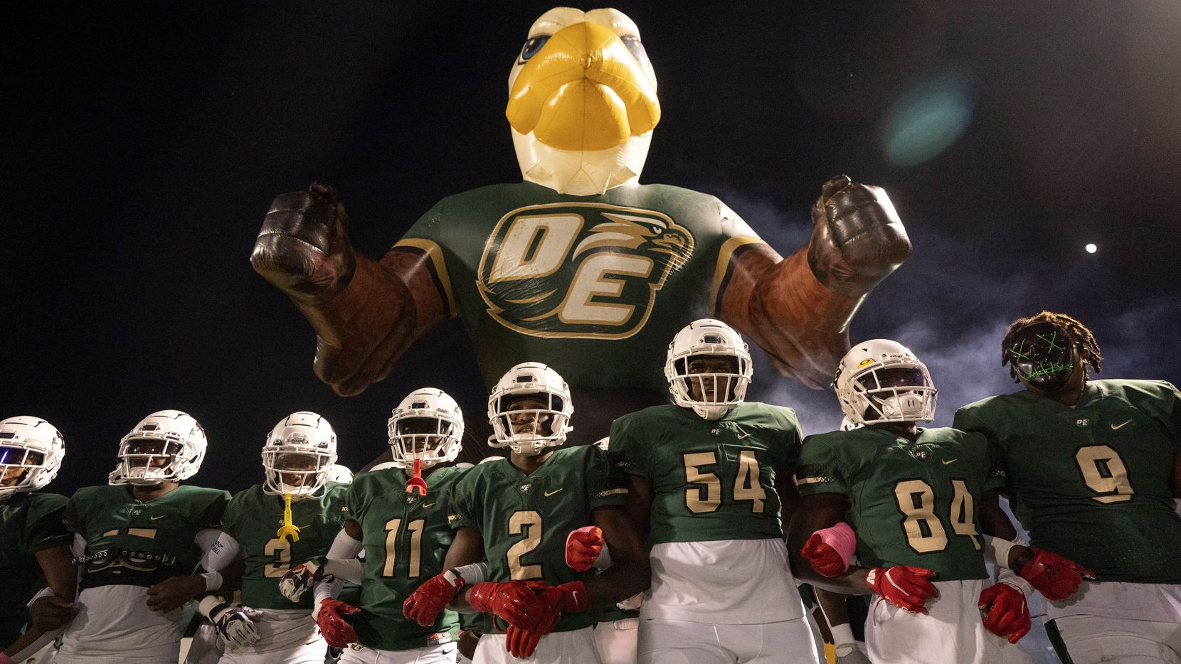 The DeSoto Eagles take the field before a high school football game against Cedar Hill on Friday, Oct. 15, 2021 at Eagle Stadium in DeSoto, Texas. (Jeffrey McWhorter/Special Contributor)