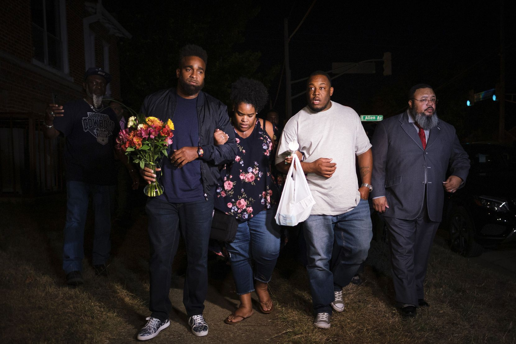 Members of the victimÕs family depart a community vigil for Atatiana Jefferson on Sunday, Oct. 13, 2019, in Fort Worth.