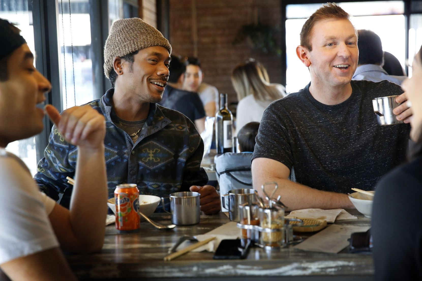 Diners share laughs over lunch at the Khao Noodle Shop, a tiny spot in East Dallas where chef Donny Sirisavath is making exciting dishes based on the Lao food of his childhood, Saturday, March 9, 2019. (Tom Fox/The Dallas Morning News)